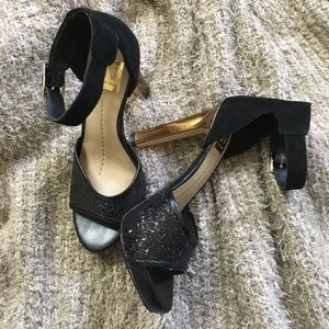 Black sequin heels with gold accents
